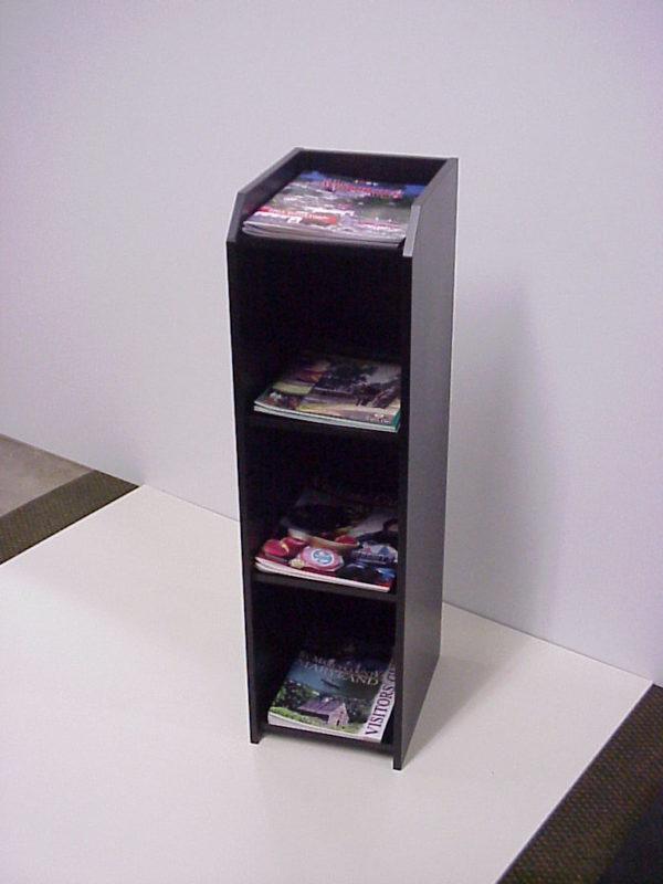 a custom floor standing magazine stand in black