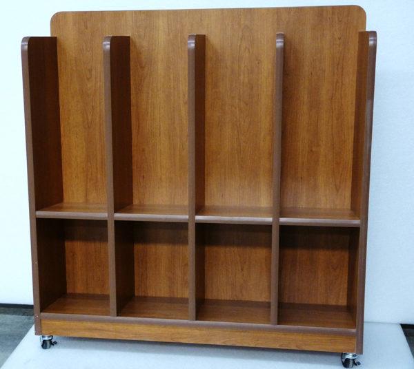 a large capacity custom magazine rack in oak with wheels