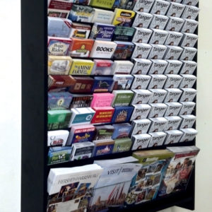 a custom wall mounted brochure rack filled with various brochures and magazines