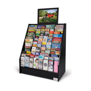 an advanced video display with a monitor above the black display stand full of brochures and magazines