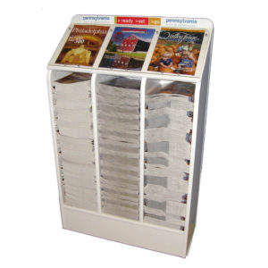 a large magazine rack full of 3 different magazines