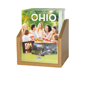 small oak wooden magazine holder for countertops, filled with magazines