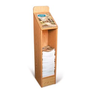 oak floor standing wood magazine rack for restaurants, partially filled with magazines
