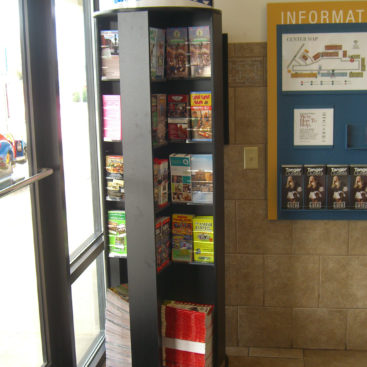 a rotating brochure rack in a visitor center lobby by the door